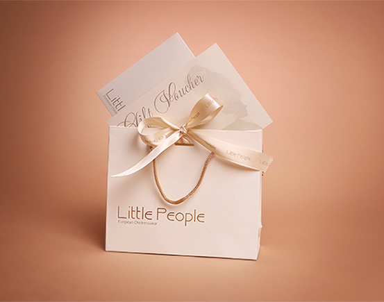 Little People children's clothing - gift voucher and gift bag
